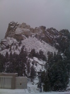 Mt. Rushmore, in Winter, stage in the foreground.