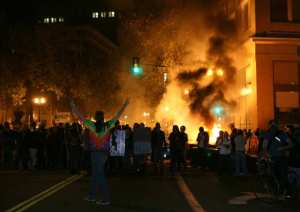 The Occupy Oakland protesters set a fire on trash to make a barricade as the police officers form a line to disperse the protesters on November 3, 2011 in Oakland, California