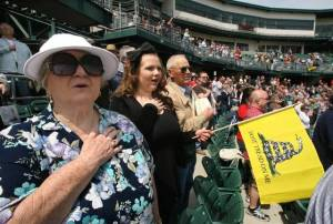 People of all ages take part in the pledge of allegiance during the Central Valley Tea Party rally at Chukchansi Park in 2010.
